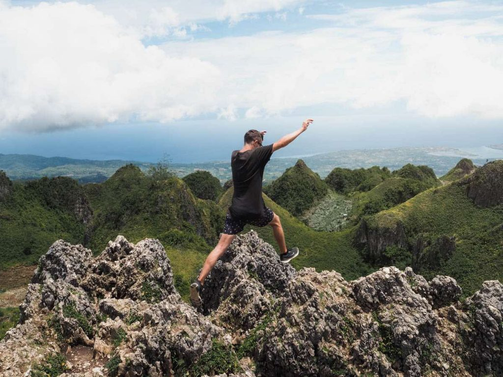 Jumping across the rocks at the top of the Osmena Peak Hike