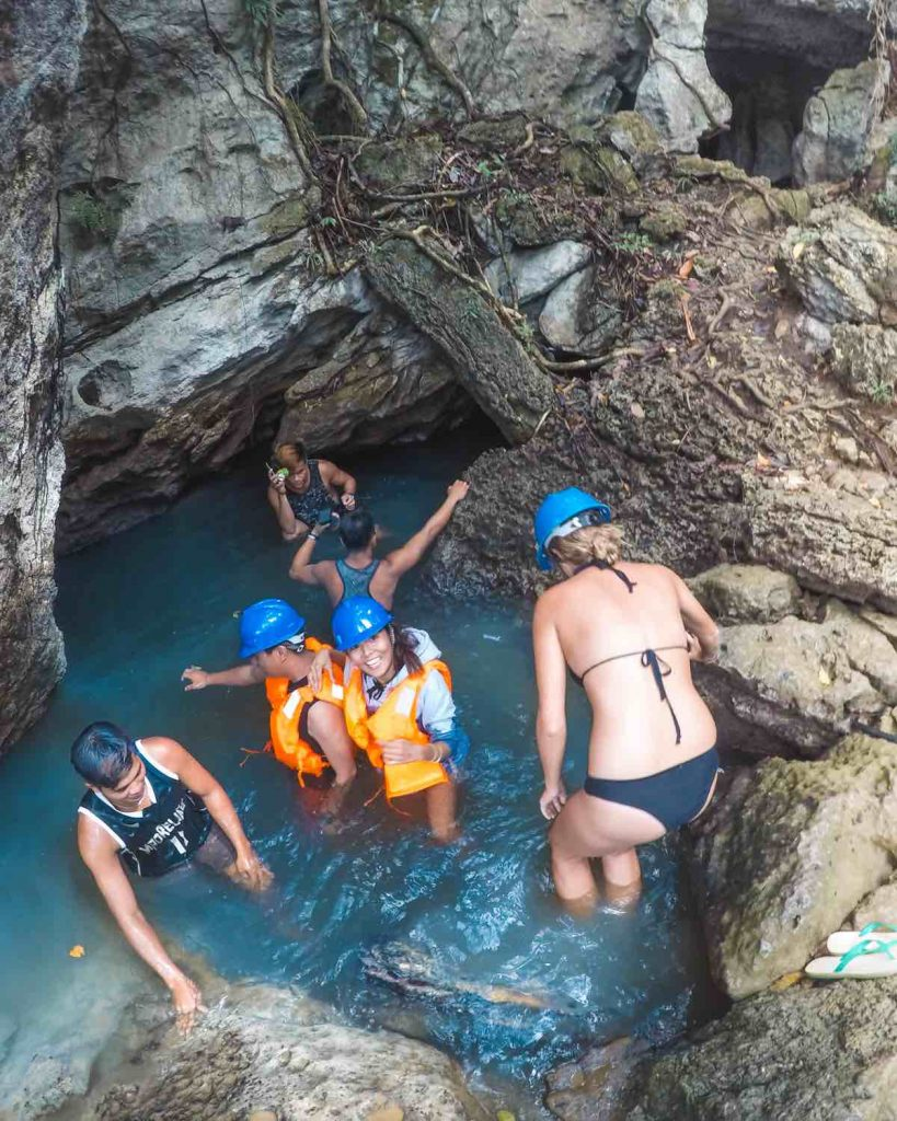 Entering the Tayangban Cave Pools with another tour exiting
